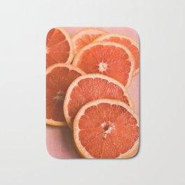 Grapefruit on Pink Bath Mat