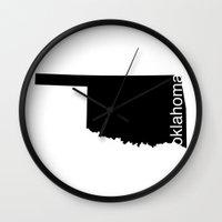oklahoma Wall Clocks featuring Oklahoma by Isabel Moreno-Garcia