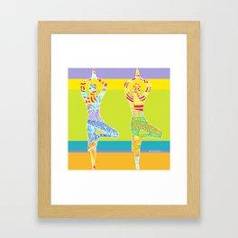 Simple silhouettes of women doing yoga Framed Art Print