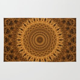 Mandala in golden and brown tones Rug