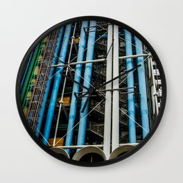 Colored pipelines on the facade of a building Wall Clock