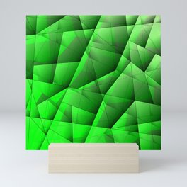 Abstract pattern of green and glowing plates of triangles and irregularly shaped lines. Mini Art Print