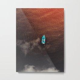 A boat on the ocean Metal Print