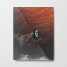 A boat on the ocean Metal Print