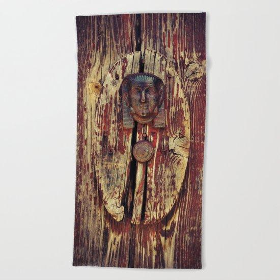 weathered wooden door with agypt door knocker Beach Towel