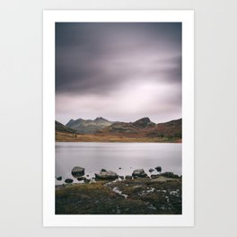 Clouds over Blea Tarn with Langdale Pikes beyond. Lake District, UK. Art Print