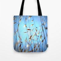 grass Tote Bags featuring grass by  Agostino Lo Coco