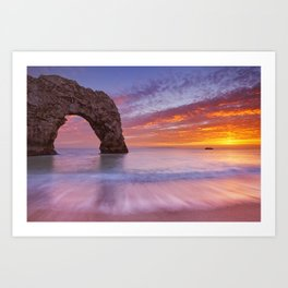 Durdle Door rock arch in Southern England at sunset Art Print