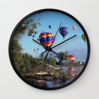 hot air balloon Wall Clocks featuring Hot air balloon scene by Bruce Stanfield