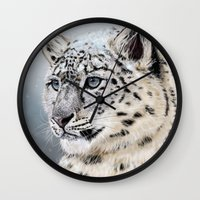 snow leopard Wall Clocks featuring Snow Leopard by Aaron Jason