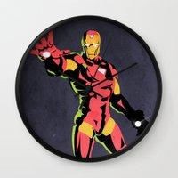 iron man Wall Clocks featuring iron man  by mark ashkenazi