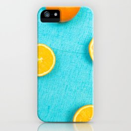 Oranges and lemons on turquoise background, citrus fruits iPhone Case