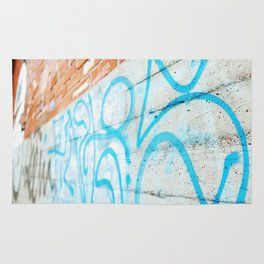 Blue graffiti on concrete wall Rug