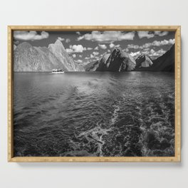 A boat ride in the morning at Milford Sound in black and white Serving Tray