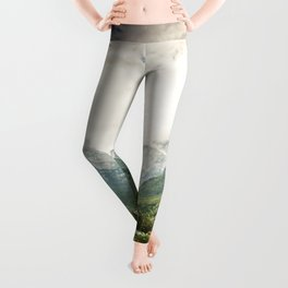 Beautiful green field with mountains in clouds Leggings