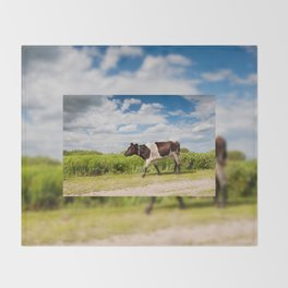 Calf walking in natural landscape Throw Blanket