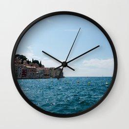 View to the city Rovinj, Croatia. Sunny day, blue sea and sky Wall Clock
