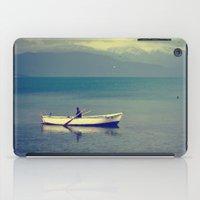 rowing iPad Cases featuring rowing a boat in egirdir lake by gzm_guvenc