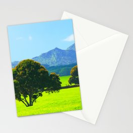green tree in the green field with green mountain and blue sky background Stationery Cards