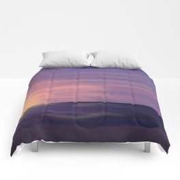 Beach at sunset Comforters
