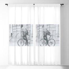 Man on bike cycling through the city Blackout Curtain