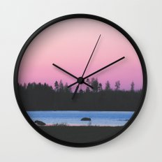 Pink skies over the lake Wall Clock