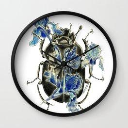 Beetle in blue irises Wall Clock