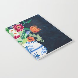 Bouquet of Flowers in Blue and White Urn on Navy Notebook