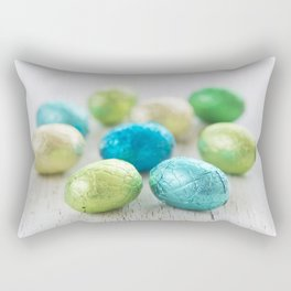 Small chocolate Easter eggs on a rustic white background Rectangular Pillow