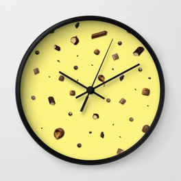 Falling chocolates with yellow background Wall Clock
