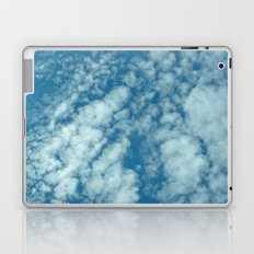 Fluffy clouds in a blue sky Laptop & iPad Skin