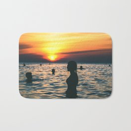 sunset swim Bath Mat