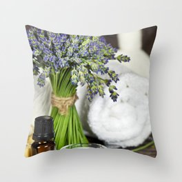 Fresh  lavender flowers, zen stones, essential oil, candle and towel over wooden surface Throw Pillow