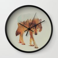 woods Wall Clocks featuring Wolf In The Woods #2 by Andreas Lie