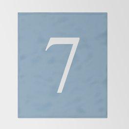 number seven sign on placid blue color background Throw Blanket