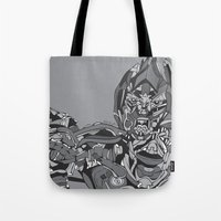 transformers Tote Bags featuring Transformers: Megatron by Skullmuffins