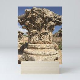 Ruins of a Roman column in Jerash, Jordan Mini Art Print