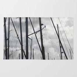 Yacht masts on cloudy sky Rug