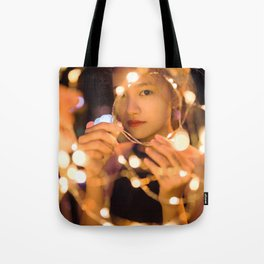 Woman Through String of Lights Tote Bag