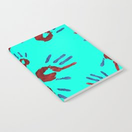 Red palm with blue fingers on neon blue Notebook