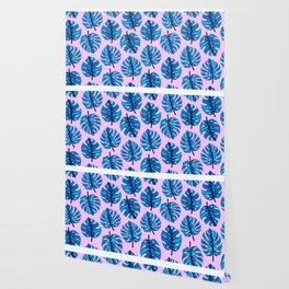 Blue monstera leaves pattern on pink background Wallpaper