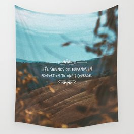 Life shrinks of expands in proportion to one's courage. Wall Tapestry