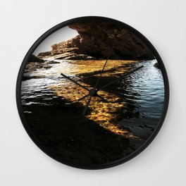 cave in the sea Wall Clock