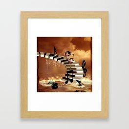 Cute little girl dancing on a piano Framed Art Print