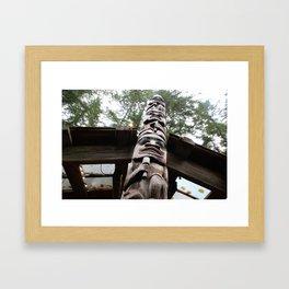 up the totem Framed Art Print