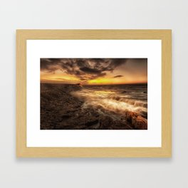 Porthcawl Sunrise with an oil painting effect on the sea Framed Art Print