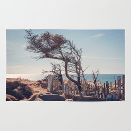 Graveyard by the sea Rug