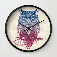 warrior Wall Clocks featuring Evening Warrior Owl by Rachel Caldwell