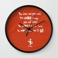 dr seuss Wall Clocks featuring dr seuss the more that you read by studiomarshallarts
