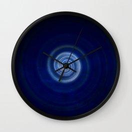 Darkest in the light Wall Clock
